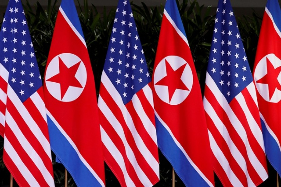 US and North Korean national flags are seen at the Capella Hotel on Sentosa island in Singapore — Reuters/Files