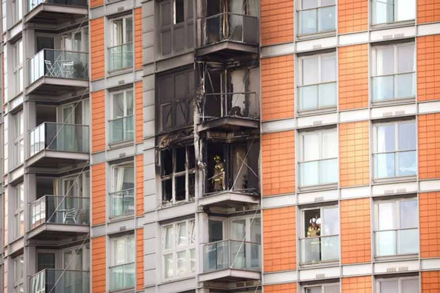 Firefighters work at a damaged residential building in East London on Friday -Reuters photo