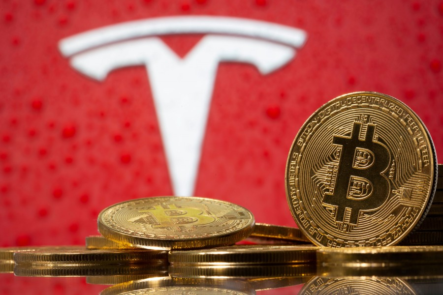 Representations of virtual currency Bitcoin are seen in front of Tesla logo in this illustration taken on February 9, 2021 — Reuters/Files