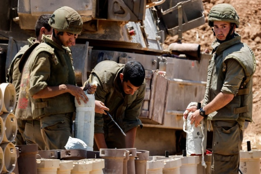 Israeli soldiers check artillery shells in an area near the border with Gaza, in southern Israel May 13, 2021 — Reuters