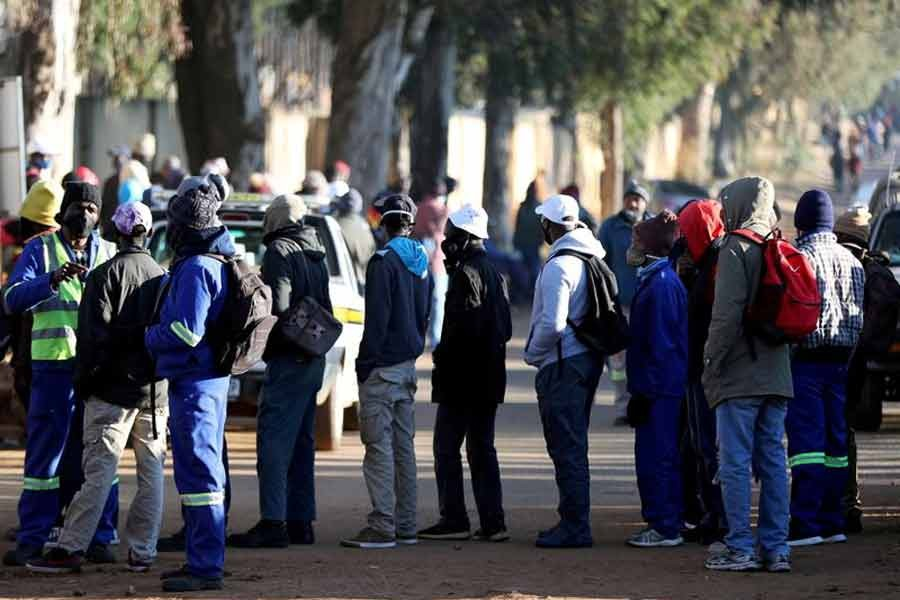 Job seekers standing outside a construction site in South Africa last year -Reuters file photo