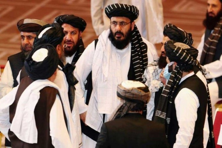 Taliban delegates speak during talks between the Afghan government and Taliban insurgents in Doha, Qatar, September 12, 2020 — Reuters/File Photo