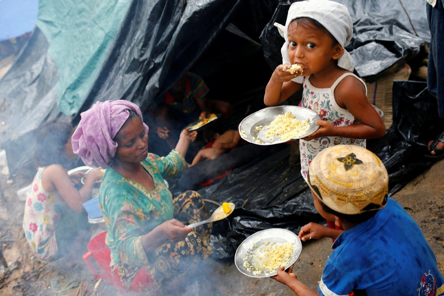 Rohingya refugees seen having their breakfast in Kutupalong Makeshift Refugee Camp in Cox's Bazar — Reuters file photo used only for representation
