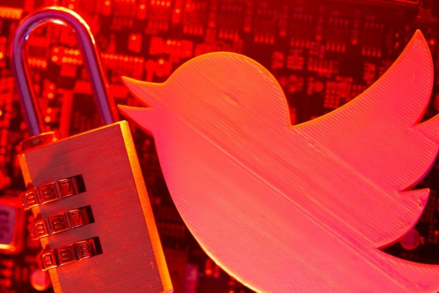 A 3D printed Twitter logo and a padlock are placed on a computer motherboard in this illustration picture taken on May 4, 2021 — Reuters/Files