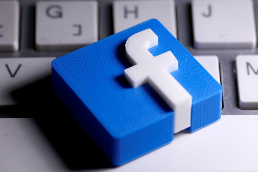 A 3D-printed Facebook logo is seen placed on a keyboard in this illustration taken on March 25, 2020 — Reuters/Files