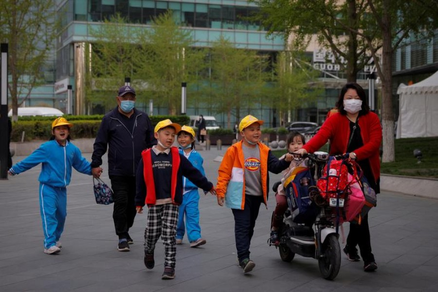 People pick up children from a school in Beijing, China on April 6, 2021 — Reuters/Files