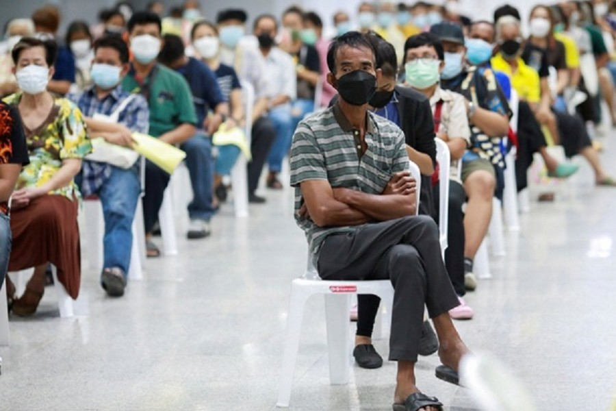People queue at the Central Vaccination Center as Thailand begins offering first doses of the AstraZeneca vaccine to at-risk groups amid the coronavirus (COVID-19) outbreak in Bangkok, Thailand, July 26, 2021.