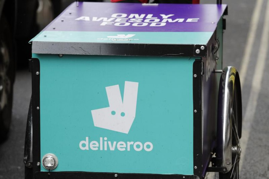 This Tuesday, July 11, 2017 file photo, shows a deliveroo logo on a bicycle in London. (AP Photo/Frank Augstein, File)