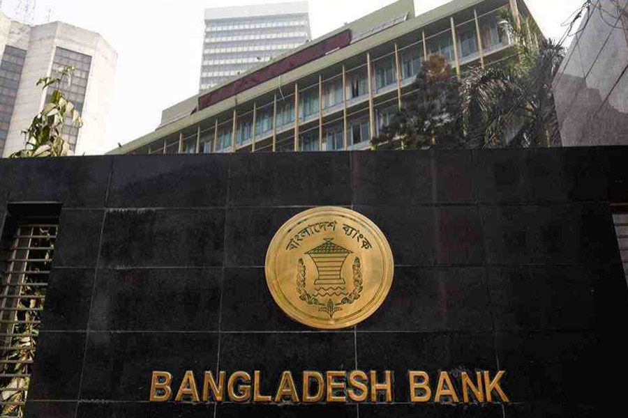 The Bangladesh Bank seal is pictured on the wall outside the central bank headquarters in Motijheel, the bustling commercial hub in capital Dhaka