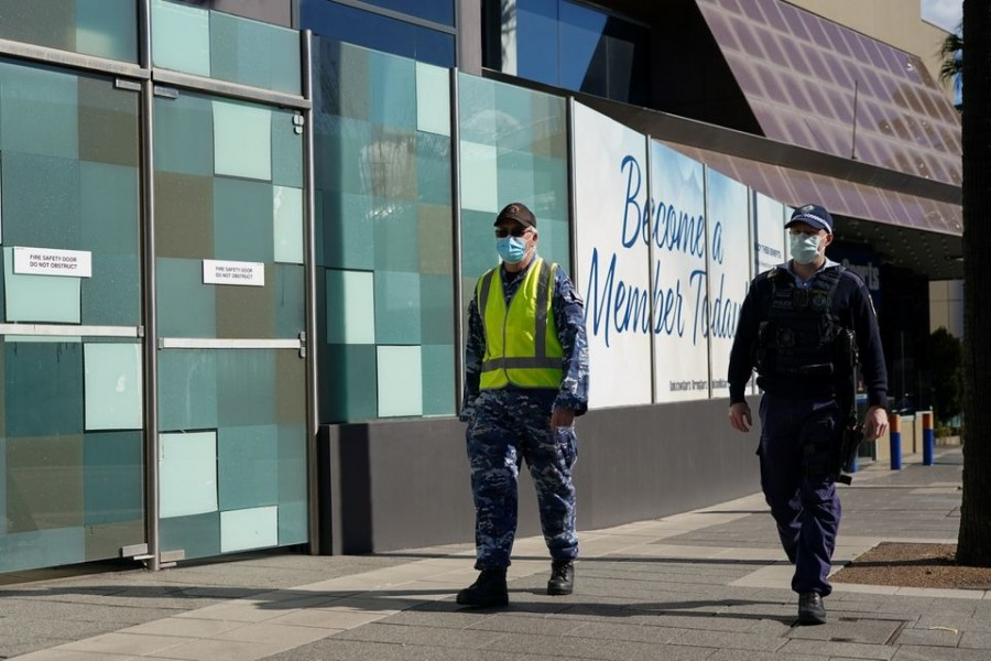Personnel from the Australian Defence Force and New South Wales Police Force patrol a street in the Bankstown suburb during an extended lockdown to curb the spread of the coronavirus disease (Covid-19) in Sydney, Australia on August 3, 2021 — Reuters photo