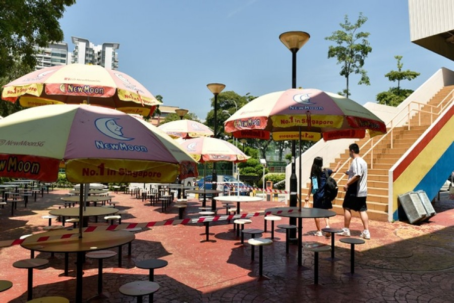 The seating area at a food centre is cordoned off to restrict dining-in as part of the latest measures to curb the coronavirus disease (COVID-19) outbreak in Singapore July 23, 2021. REUTERS