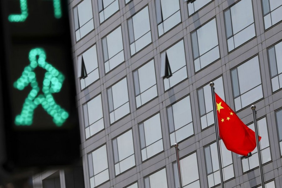 A Chinese national flag flutters outside the China Securities Regulatory Commission (CSRC) building in Beijing, China on July 9, 2021 — Reuters/Files
