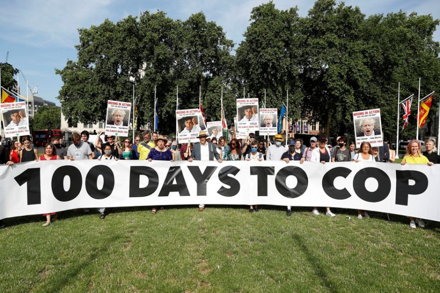 Protesters from the Climate Coalition demonstrate, with 100 hundred days to go before the start of the COP26 climate summit, in Parliament Square, London, Britain, July 23, 2021. REUTERS/Peter Nicholls/File Photo