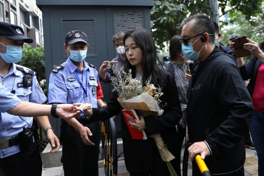 Zhou Xiaoxuan, also known by her online name Xianzi, arrives at a court for a sexual harassment case involving a Chinese state TV host, in Beijing, China on September 14, 2021 — Reuters photo