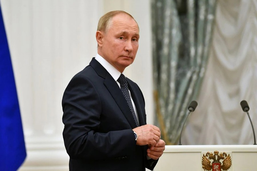 Russian President Vladimir Putin looks on during a meeting with athletes, participants of the 2020 Tokyo Olympic Games, in Moscow, Russia on September 11, 2021 — Kremlin via REUTERS