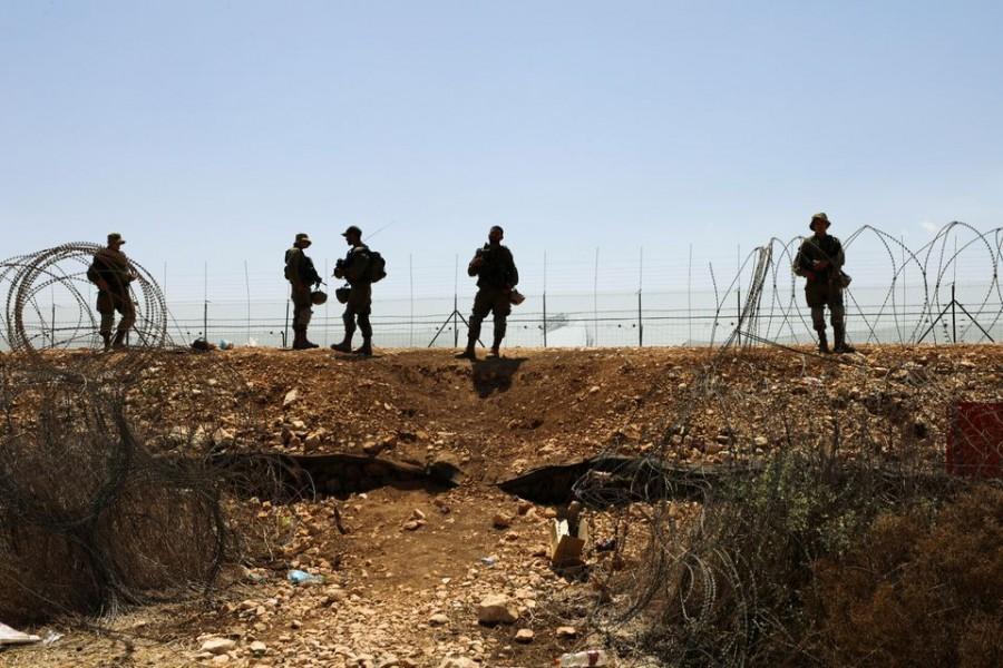 Israeli soldiers guard along a fence leading to the Israeli-occupied West Bank, as part of search efforts to capture six Palestinian men who had escaped from Gilboa prison earlier this week, by the village of Muqeibila in northern Israel September 9, 2021. REUTERS/Ammar Awad/File Photo