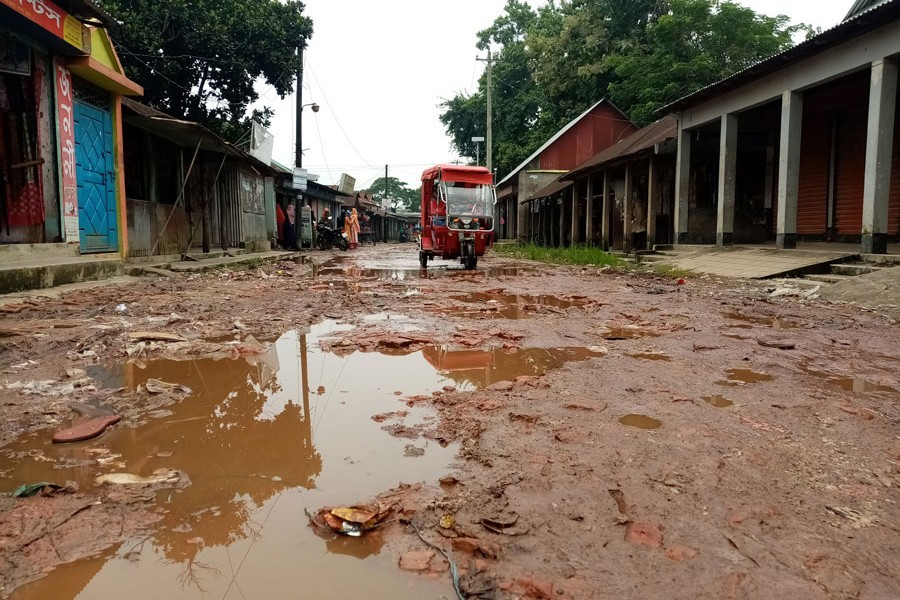 The dilapidated Rupganj Bausi Bazar road at Barhatta Upazila of Netrakona — FE Photo