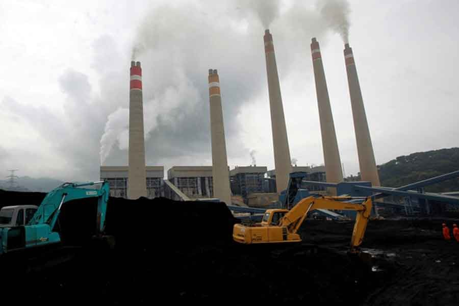Excavators piling coal in a storage area in an Indonesian Power Plant -Reuters file photo