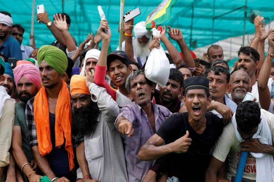 People shout slogans during a Maha Panchayat or grand village council meeting as part of a farmers' protest against farm laws in Muzaffarnagar in the northern state of Uttar Pradesh, India, September 5, 2021 -- Reuters