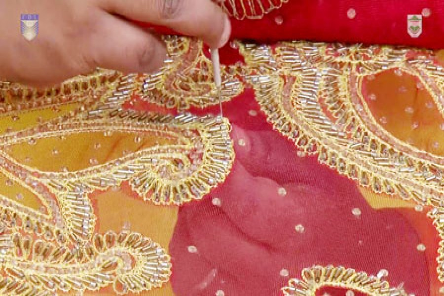 rural craftswomen busy doing needlework before eid