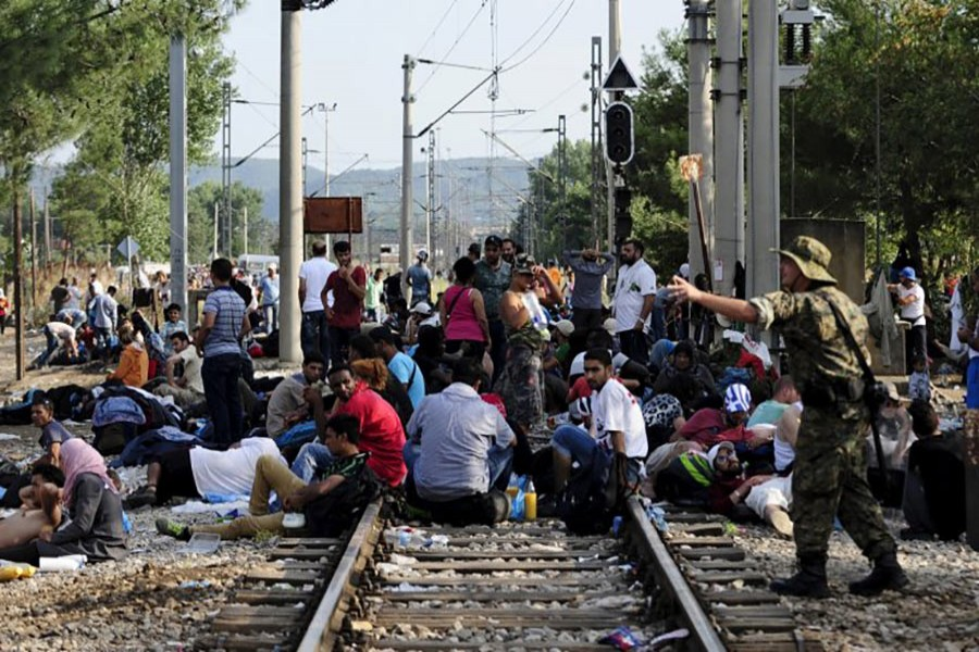 Macedonian special police guard the border as more than a thousand immigrants wait at the border line of Macedonia and Greece. - Reuters file photo