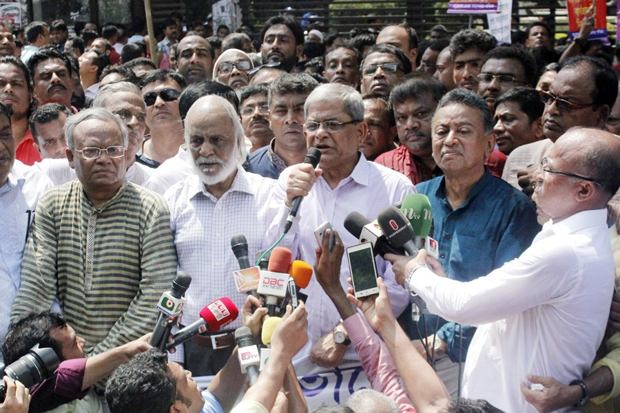 BNP secretary general Mirza Fakhrul Islam Alamgir speaking at a human chain, as part of their  +98countrywide programme, protesting violence on Rohingya migrants in front of the National Press Club in the city on Friday.— Focus Bangla