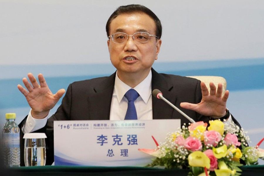 China's Premier Li Keqiang speaks during a news conference of 'The Round Table Dialogue' meeting at Diaoyutai State Guesthouse in Beijing, China September 12, 2017. (Reuters)