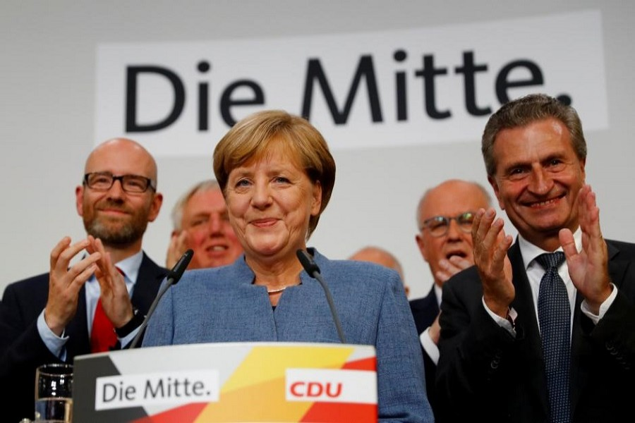 Christian Democratic Union CDU party leader and German Chancellor Angela Merkel reacts after winning the German general election (Bundestagswahl) in Berlin, Germany, Sept 24, 2017. Reuters