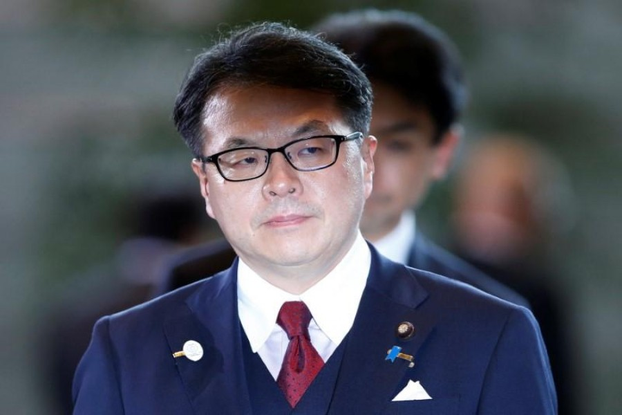 Japanese minister gives back salary over scandal