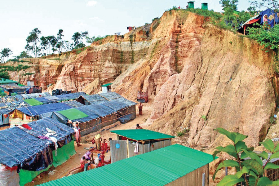 Rohingya refugees live in shanties on hill slopes at Ukhia in Cox's Bazar although a spell of downpour may trigger a landslide that may be devastating. The photo was taken on Thursday. 	— Focus Bangla
