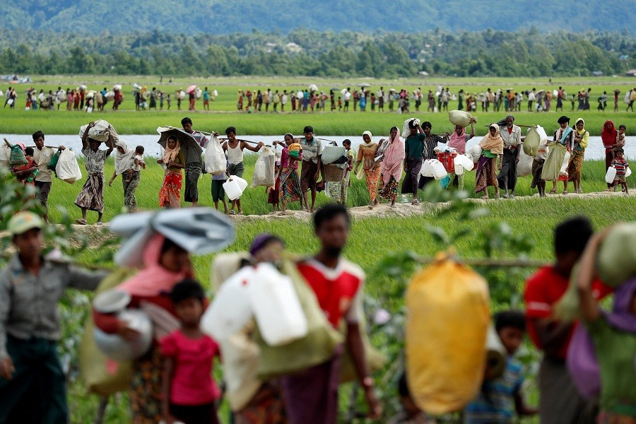 Rohingya refugees walk after they received permission from the Bangladeshi army to continue on to the refugee camps, in Palang Khali, near Cox's Bazar, Bangladesh October 19, 2017. Reuters/File Photo