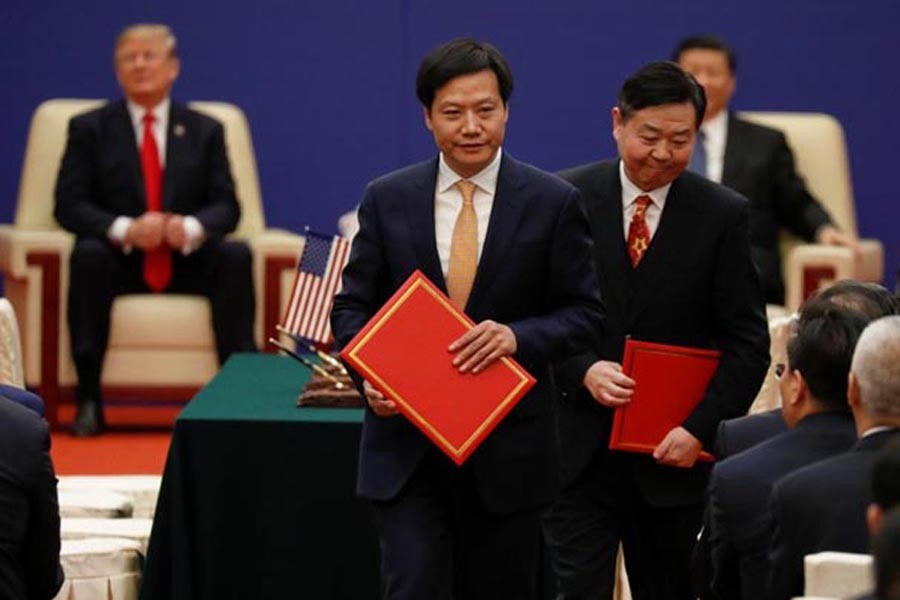 Lei Jun, Founder and CEO of China's smartphone maker Xiaomi, attends signing ceremony with US President Donald Trump and China's President Xi Jinping at the Great Hall of the People in Beijing on November 09, 2017. 	—  Reuters