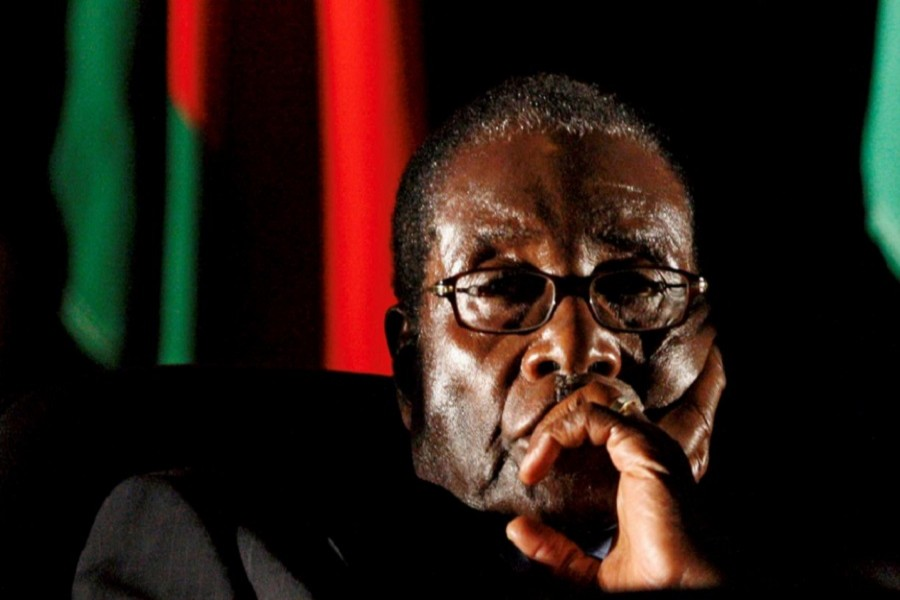 Zimbabwean President Robert Mugabe watches a video presentation during the summit of the Southern African Development Community in Johannesburg, South Africa August 17, 2008. Reuters/File Photo