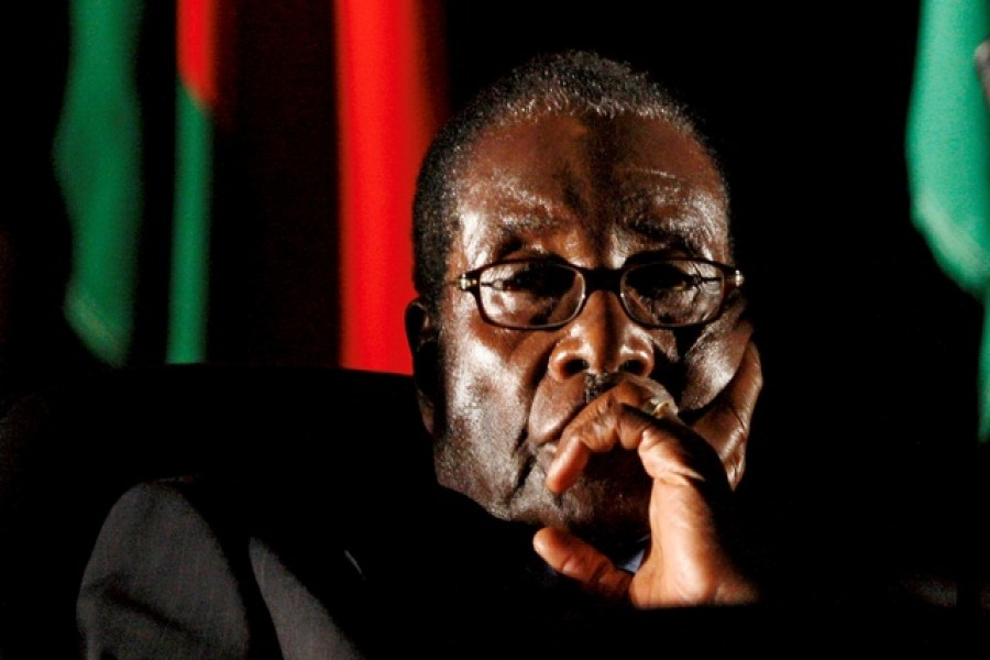Zimbabwean President Robert Mugabe watches a video presentation during the summit of the Southern African Development Community (SADC) in Johannesburg, South Africa Aug 17, 2008. - Reuters