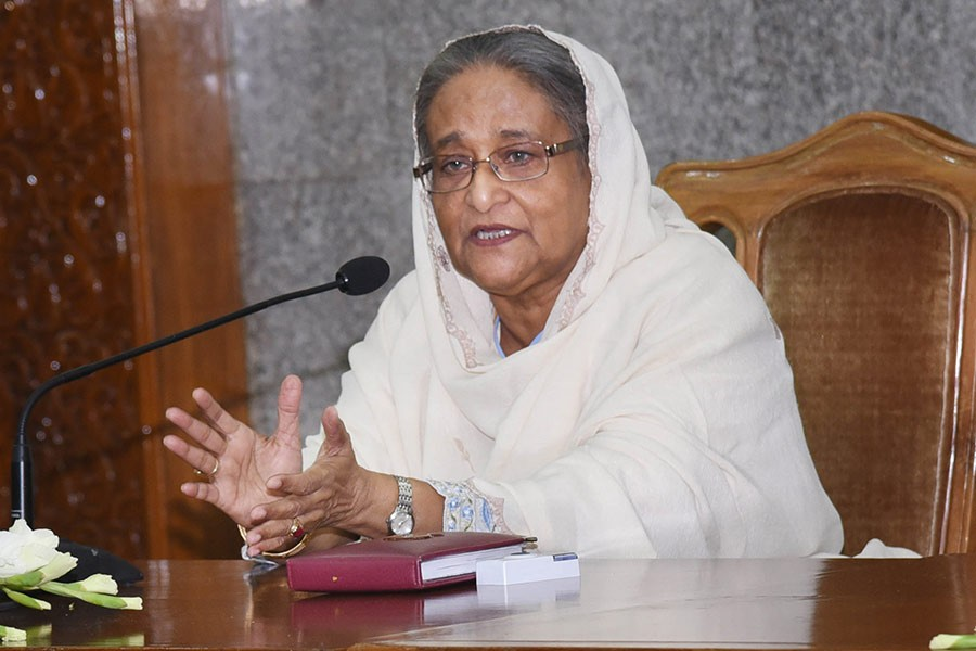 Prime Minister Sheikh Hasina addresses a function on Monday at her office. 33 commercial banks handed over blankets to PM's relief and welfare fund. -Focus Bangla Photo