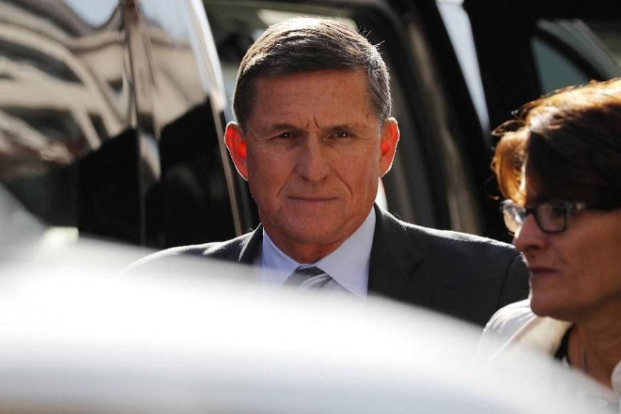 Former US National Security Adviser Michael Flynn arrives for a plea hearing at US District Court, where he pleaded guilty to lying to the FBI about his contacts with Russia's ambassador to the United States, in Washington, US, December 1, 2017. Reuters