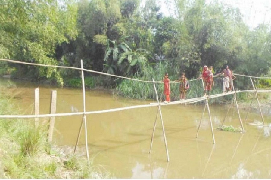 Over 1000 students attend schools crossing this rickety bamboo bridge twice a day: FE Photo