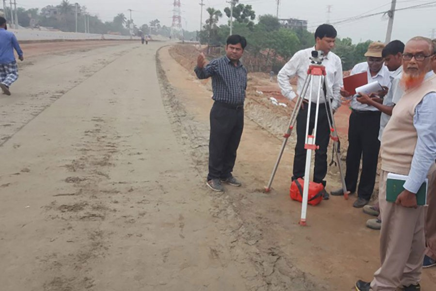 Dhaka-Tangail highway project staff conducting survey. - Photo collected from Facebook