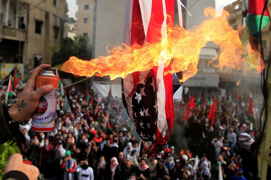 Protesters set a US flag on fire near the US embassy in Beirut, Lebanon Dec 10, 2017. Reuters