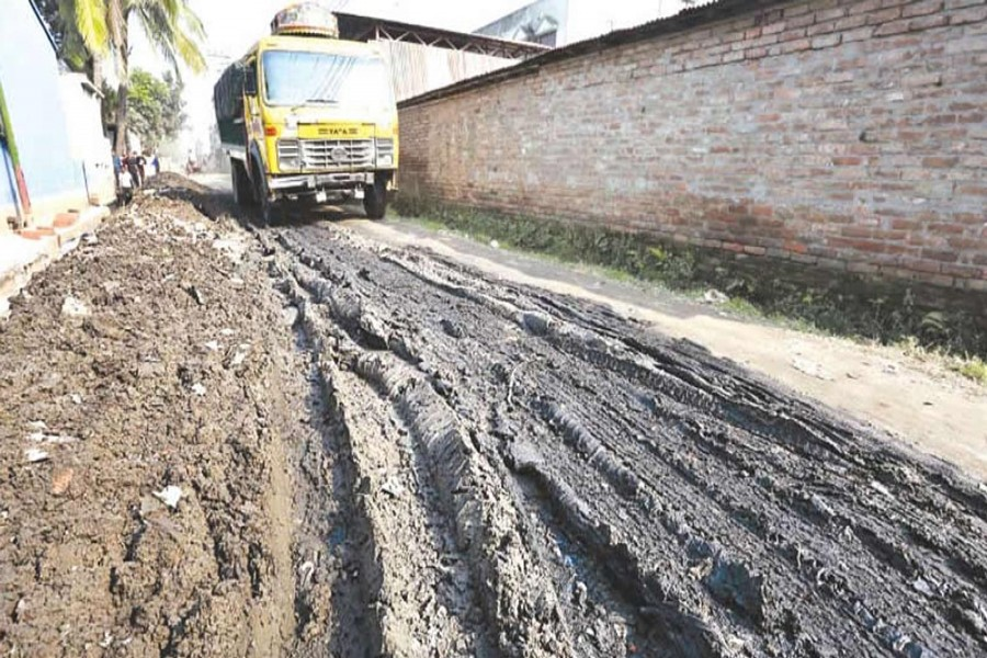 BOGRA: A miserable view of BSCIC road, causing untold sufferings to passers-by and vehicles at Fulbari under Sadar upazila of Bogra district.	— FE photo