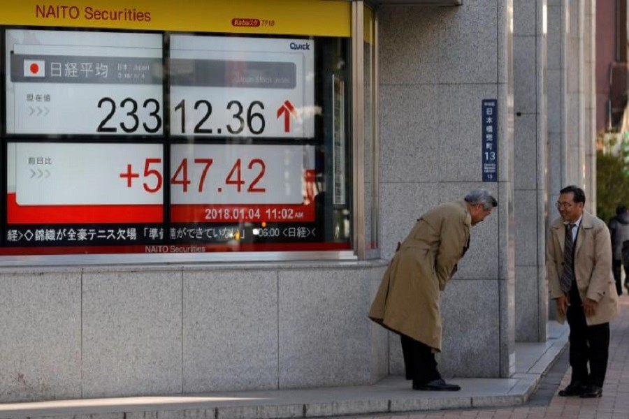 Asian shares hover near record level
