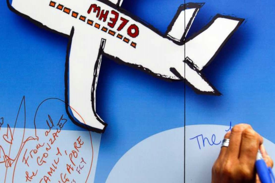 In this file photo, well wishes are written on a wall during a remembrance event for the ill-fated Malaysia Airlines Flight 370 in Kuala Lumpur, Malaysia.  – AP photo