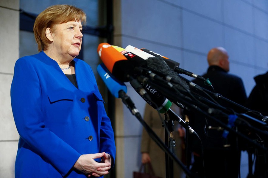 Acting German Chancellor Angela Merkel arrives for exploratory talks about forming a new coalition government at the SPD headquarters in Berlin, Germany on Thursday. - Reuters photo