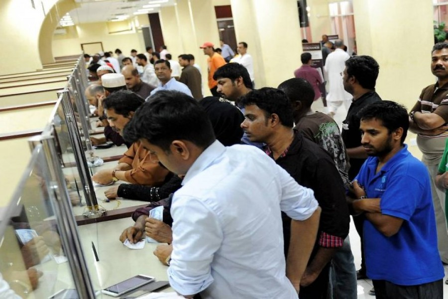 Expats in queue at an exchange house in Doha. - Peninsula Qatar