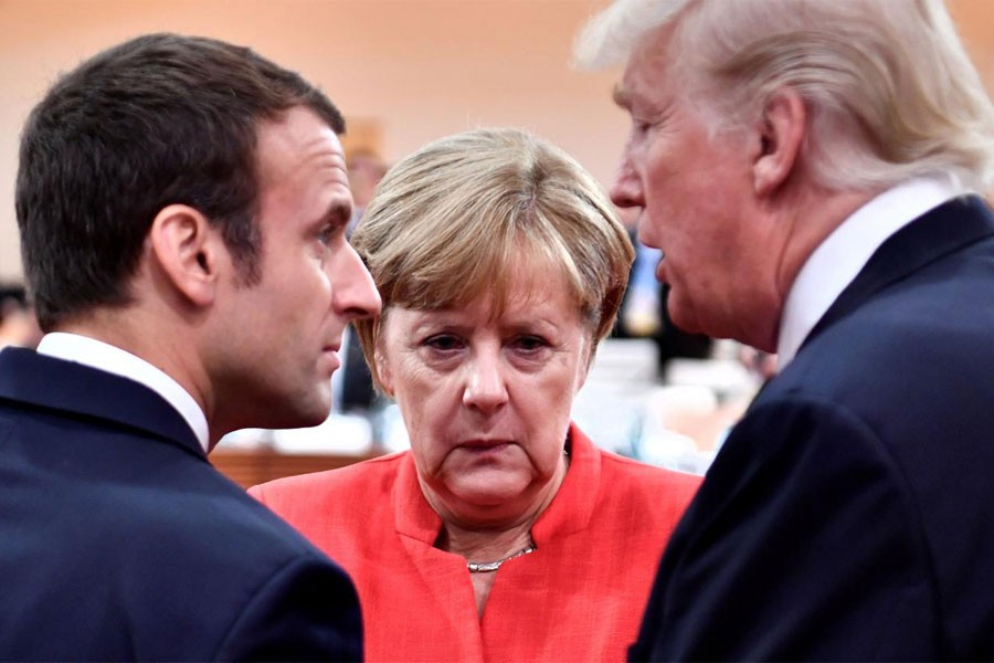 French President Emmanuel Macron, German Chancellor Angela Merkel and US President Donald Trump confer at the start of the first working session of the G20 meeting in Hamburg, Germany, July 7, 2017. (REUTERS)
