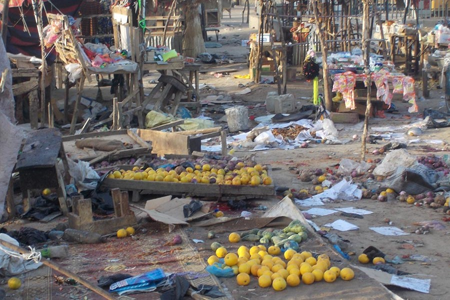 Fruits and scattered stalls are seen at the Muna Garage after two male suicide bombers detonated the bombs in Maiduguri, Nigeria, on Wednesday. - Reuters photo
