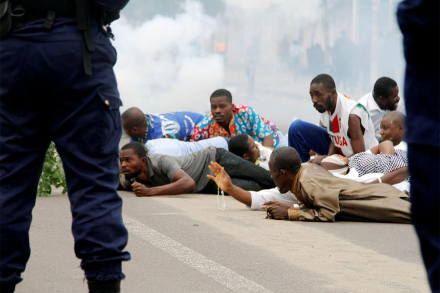 Riot policemen fire teargas canisters to disperse demonstrators during a protest organised by Catholic activists in Kinshasa, Democratic Republic of Congo January 21, 2018. (REUTERS)
