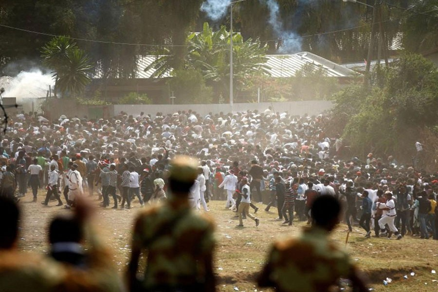 Protestors run from tear gas launched by security personnel during the Irecha, the thanks giving festival of the Oromo people in Bishoftu town of Oromia region, Ethiopia, 2 October, 2016. (Reuters photo used for representation)