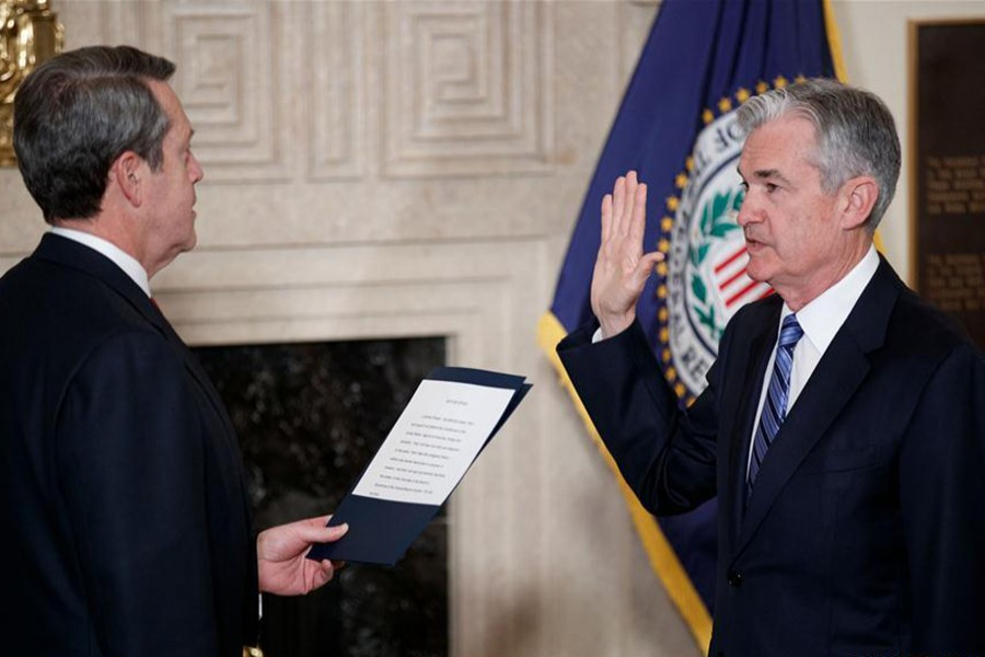 Jerome Powell (R) takes the oath of office as Chairman of the US Federal Reserve, succeeding Janet Yellen, in Washington, United States on Monday. - Xinhua photo