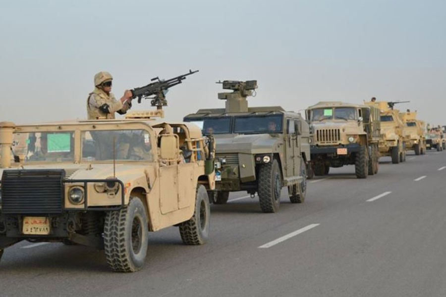 Egyptian Army's Armoured Vehicles are seen on a highway to North Sinai during a launch of a major assault against militants, in Ismailia, Egypt. (Reuters)